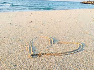 Heart drawn in the sand on a beach