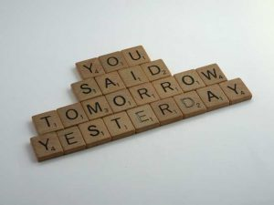 Scrabble tiles that say You Said Tomorrow Yesterday
